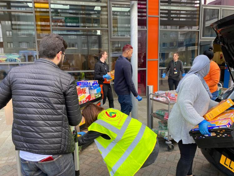 Kurdish activists distributing food to homeless people in North London