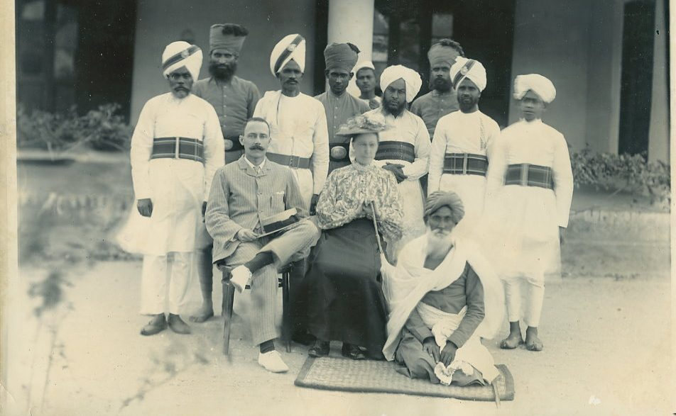 A British couple with Indian police forces in the 1900s